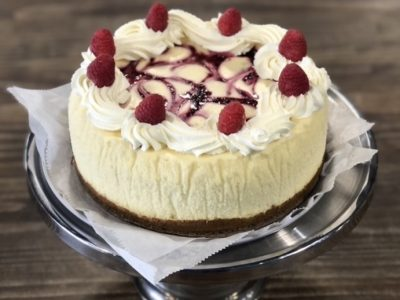 Original Cheesecake with a graham cracker crust and fresh raspberry sauce swirled in. Topped with fresh whipped cream and raspberries.
