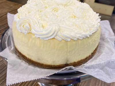 Original Cheesecake with a graham cracker crust. Topped with fresh whipped cream.